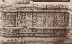 Close view showing moulding and sculptural detail on an unidentified temple, Aihole